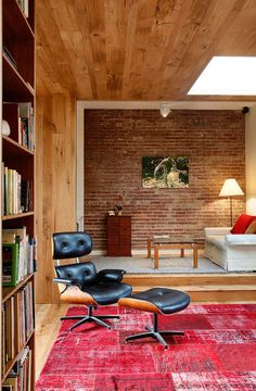 Love this room. The brick in the background and that rug are both amazing! @Mike Tucker McDowell #living #space #rugs
