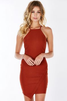Sensual, classy, chic.. the list goes on! This beautiful mini dress features a high neckline with delicate spaghetti straps. Envelope detail in front and hidden zipper in back for closure. Perfect for