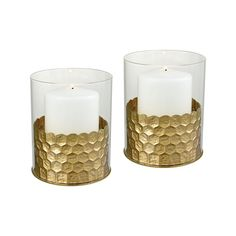 Dimond Home Nectar Hurricanes. A gold nectar hurricanes made of metal and glass.