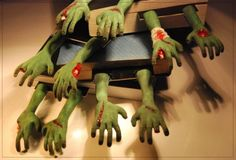 Very realistic, one-of-a-kind zombie's hands bookmarks. By Anna Sternik on Etsy