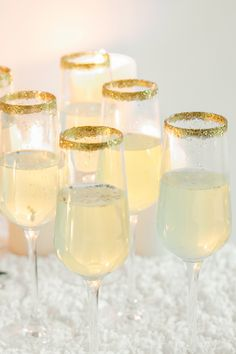 If you didn't know by now, you should have a champagne toast at your wedding. To glam it up, dip the rims in edible gold glitter.