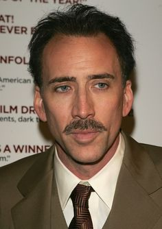 The mustached man: | The 18 Most Important Hairstyles Of Nicolas Cage's Life