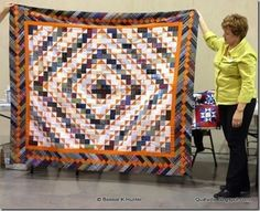 Susan used a lovely pumpkin orange in her Bricks in the Barnyard quilt, from Scraps & Shirttails II!  Signed copies of the book can be ordered here: http://quiltvil.startlogic.com/store/index.html