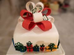 Christmas parcel cake with petite present decorations around the cake