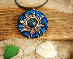 Bronze Sun and Dichroic Glass Pendant by TedsArtGlass on Etsy