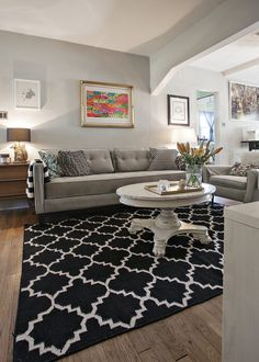 black and white rug. And I love the color of the coffee table. I could do a small coffee table or foot stool in that color