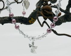 https://www.kinderschmuck-silberschmuck.de/Taufschmuck/Schutzengel/Engel-Design/Kinderschmuck-Kinderkette-first-pearls-Gravur-Taufschmuck::1158.html