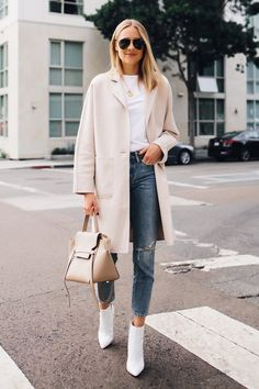 Nov 2019 - Team a beige coat with blue ripped jeans to pull together a seriously chic and modern-looking off-duty ensemble. White leather ankle boots are an effortless way to add a confident kick to the look. Amy Jackson, White Leather Ankle Boots, White Boots, Womens White Ankle Boots, Boots Women, Winter Maxi, Casual Winter, Mens Winter, Stylish Winter Clothes