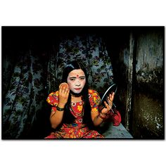 The girls use a lot of powder to lighten their skin-light skin to them is more beautiful.Falkland Road, Bombay, India.   1978 by Mary Ellen Mark