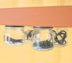 Use Jars as Floating Storage Spaces Fill small jars with tacks, nails, buttons, or other easy-to-lose supplies, then attach the lid of each jar to the underside of a shelf. Voilà! Instant storage without wasting a precious inch of shelf space.