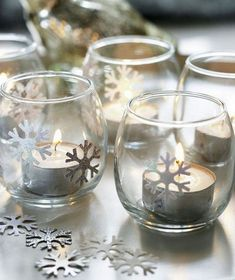 9 Homemade Holiday and Christmas Decorations Frosty Lights - Want to create a tabletop winter wonderland? Add snowflake stickers to clear glass votives and sprinkle them along your tablescape. Winter Wonderland Decorations, Winter Wonderland Theme, Winter Wonderland Christmas, Wonderland Party, Winter Christmas, Winter Decorations, Simple Christmas, Xmas, Minimal Christmas