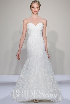 Brides.com: . Style 14084, strapless fit-and-flare wedding dress with a ruched…