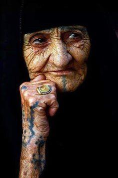 Iraqi woman with traditional tattoos.