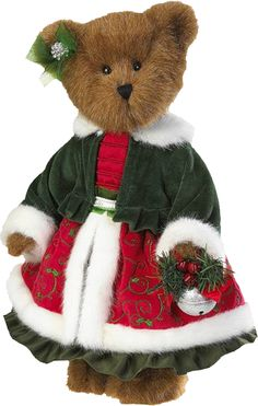 ...teddy always looks nice and cozy sitting near the Christmas tree...