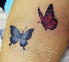 butterflies on thigh tattoo by johnny gage,   want these around my chinese writing tat on my side!