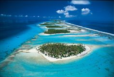 "***RESEARCH THIS FOR OUR DECEMBER TRIP**  Rangiroa is the world's second-largest coral atoll, and about as languorous and remote a place as you'd care to find. Most come here for diving, but what is wrong with just lazing around on the beach and sipping cocktails?  There's also a huge lagoon that's more like a massive inland sea, sure to add to your expanded consciousness and sense of perspective – even the name 'Rangiroa' means ""vast sky""."