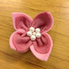 How to make a super simple felt flower via @Guidecentral - Visit www.guidecentr.al for more #DIY #tutorials