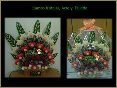 arreglo frutal con estrellas de piña, corazones de patilla, adornos de melon , fresas, con cobertura de chocolate y hojas talladas de pepino