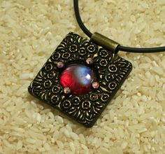 Square polymer clay pendant with red glass gem & 4 Swarovski crystals by Sweet2Spicy, via Flickr
