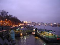 Westminster Pier, London, Victoria Embankment and Hungerford Bridge in background. 14 January 2006. Photographer: Fin Fahey.