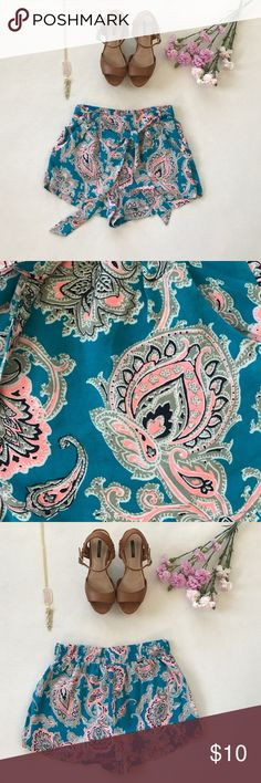 Charlotte Russe Print Shorts In great condition only worn once. These are super light and comfortable. It has a waistband that stretches on the back and can be tied in the front. It also has two functional pockets in the front. 100% Rayon. Approximately 2 inch inseam. Nice teal and pink print. Charlotte Russe Shorts