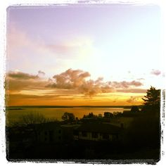 Sun setting over #Seattle on St. Patrick's Day. #travel #views