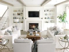 open concept living room neutral decor white couches white sofa builtins fireplace tv above fireplace living room beams - July 20 2019 at Living Room Furniture Layout, Living Room Storage, Cozy Living Rooms, Living Room Grey, Modern Furniture, Antique Furniture, Rustic Furniture, Furniture Ideas, Furniture Stores