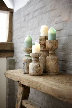 Love these rustic candle holders and neutral, sea glass colored candles