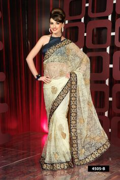 Off white net designer saree with embroidery border comes with shiny blue color blouse