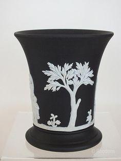 Vintage Wedgwood black basalt Jasperware vase. Featuring classical figures, ladies & cherubs. Based having impressed marks 'WEDGWOOD', 'MADE IN ENGLAND' and P 68 Date of manufacture: 1968