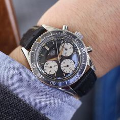 A 1960s Valjoux 72 Heuer Autavia 2446 2nd execution on the wrist. Derived from an amalgam of the word Automobile and Aviation - Autavias were the timepiece of choice for racing car drivers of their day.
