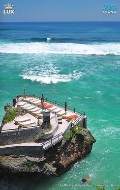 Ayana Rock Bar in Jimbaran, Bali, Indonesia. Stunning views at world famous bar- perched spectacularly on the cliff face of the Jimbaran coastline.