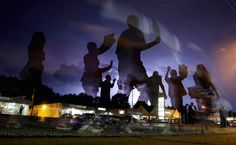 <em><b>In this unranked gallery, TIME presents the top 100 photos of the year</em></b><br>Protesters march in the street as lightning flashes in the distance in Ferguson, Mo, Aug. 20, 2014.