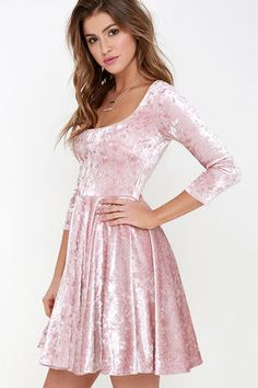 Whats better than love at first sight? The everlasting love that you'll have for the I Love You Amore Blush Pink Velvet Skater Dress! Luxuriously soft and stretchy velvet fabric hugs your curves from a scoop neckline down half sleeves and a fitted bodice with darting. A fit and flare silhouette is created by a tapered waistline above a flirty skater skirt. Lined in stretch knit. Self: 68% Acetate, 32% Rayon. Lining: 100% Polyester. Dry Clean Only. Made With Love in the U.S.A.