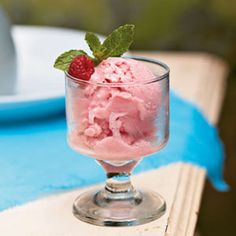 Raspberry Frozen Yogurt Recipe  This light, refreshing frozen yogurt makes an ideal finish for a multicourse meal. Serve with biscotti and a garnish of fresh mint sprigs.  I would use strawberries not in syrup and splenda instead of surgar...just saying. trying to keep the calories down. :-)