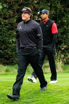 Phil Mickelson  and Tiger Woods at Pebble Beach;  Their expression says it all- night and day those two!