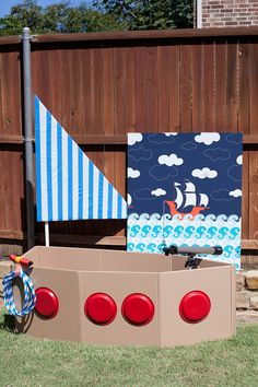 CARDBOARD SAIL BOAT: lovely nautical activity for little ones. Those paper plate portholes look great!