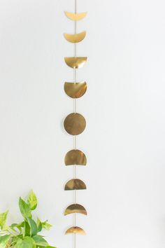 DIY moon phases wall garland: Make this easy moon phases wall hanging with gold…