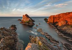 Bowfiddle Rock Sunset, Moray, Scotland by Mike Beattie  A beautiful early May Sunset taken at Bowfiddle Rock on the Moray Coast Scotland. I recommend to visit Mid May-Early June when the Pink Sea Thrift flowers are in full bloom and the sun is able light up the North facing Moray Coast.  http://lp-mag.com/fu4w Reposted Via @landscapephotomag