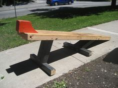 Homemade motorcycle lift constructed from lumber and plywood.