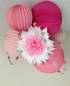 "My version of DIY nursery pom and garland combined with Martha Stewart paper lanterns.  Several tutorial ""pinspirations"" were combined to make this!"