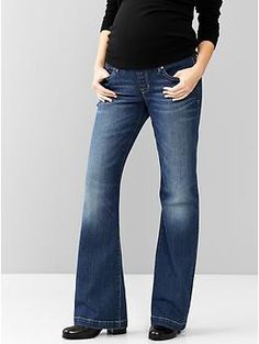 - Long and lean medium wash flare stretch faux fly jeans - Demi panel, 5 pocket - Cotton, polyester, spandex - Product #158