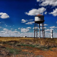 """Getting my kicks on Route 66. Something for everyone on a long #CrossCountry #roadtrip  Affectionally known as the """"Leaning Water Tower of Groom"""" is another roadside oddity you will find along I-40 or Route 66  #texas #groom #groomtexas #watertower #britten #clouds #landscapes #route66 #middleofnowhere #roadside #roadsideoddity #I40 #roadtrip #worldrider #iphonephotography #plains #prairie #weird #staycurious #neverstopexploring"""