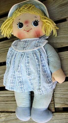 I'm looking for a 12 inch blond Knickerbocker cloth doll with big round eyes, wearing a pink and white gingham dress, and a musical wind up in her back. Rock A Bye Baby, Holly Hobbie, Kewpie, Gingham Dress, Searching, Doll Clothes, To My Daughter, Old Things, Plush