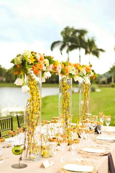 Amazing tall centerpieces in golden yellow | Polo Inspired Wedding Ideas via TheELD.com | The Majestic Vision and Krystal Zaskey Photography!