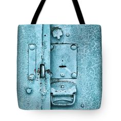 Age Tote Bag featuring the photograph Close Up Of Padlock And Old Metal Hasp On An Vintage Door by Oksana Ariskina  #OksanaAriskina #OksanaAriskinaFineArtPhotography #FineArtPhotography #HomeDecor #FineArtPrint #Bag #PrintsForSale #ToteBag #Lock #Blue #Grunge #Door