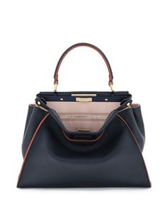 "Fendi ""Peekaboo"" bag in tricolor calfskin leather. Tote handle with rings; adjustable, removable shoulder strap. Framed top with turn-lock closure. Inside, leather lining; two compartments; one pocket"