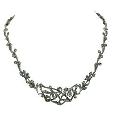 I really like the twisting of the metal vines. I think it relates to the vines in my research. Adult women who like simple jewelry designs would be the target market for this necklace.