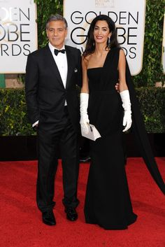 George Clooney in Giorgio Armani with Amal Clooney in Dior Haute Couture and Harry Winston. [Photo by Tyler Boye]