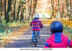 Two little kids boys, best friends in autumn park cycling with bikes. Active siblings, children with bicycles. Best friends enjoying sunny warm day. - stock photo